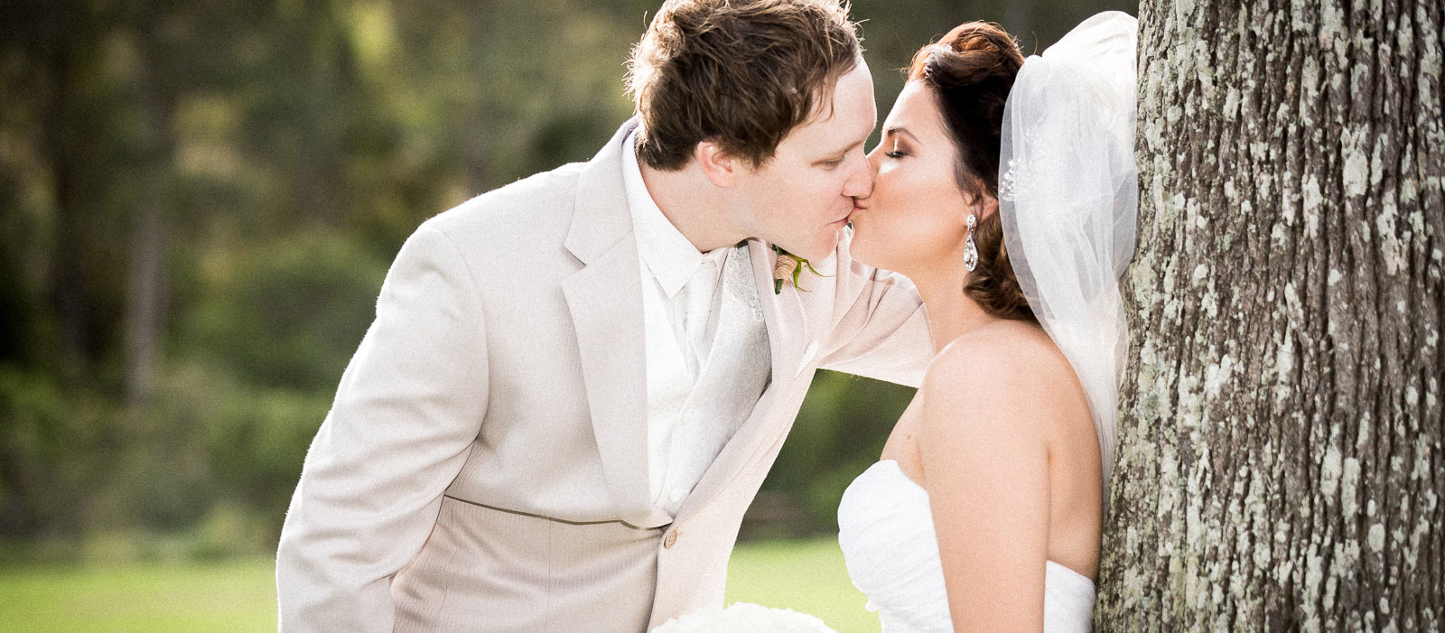 Bride and groom kissing from Gold Coast wedding photography portfolio