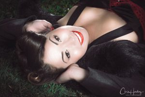 Pinup Lying On Grass