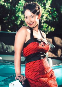 Pinup Model Leaning on Chevy