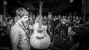 Mitch King Holding Guitar at Blues on Broadbeach