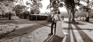 Bride and Groom Sepia Wide Shot