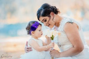 Bride and Daughter With Bouquet