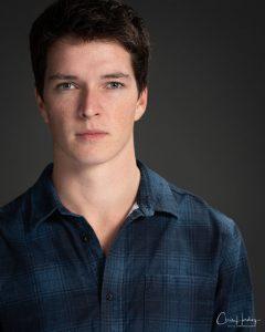 Male Actor Headshot Grey Background