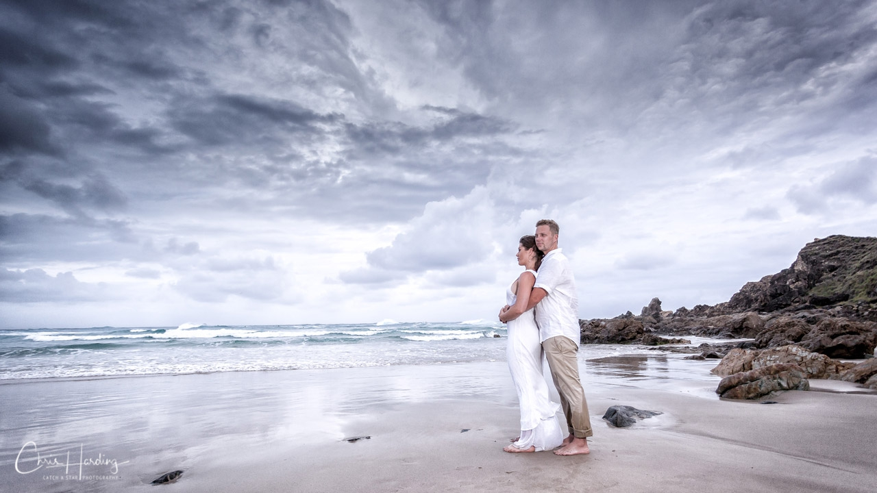 Bride and Groom Standing on Beach Wide