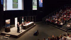 Speaker at Lecturn in Auditorium