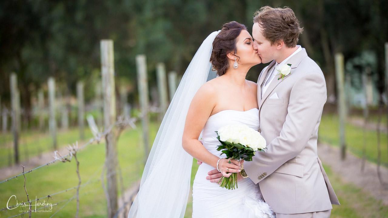 Bride and Groom Kissing at Vineyard