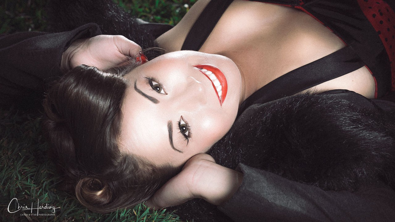 Pinup Model Lying on Grass