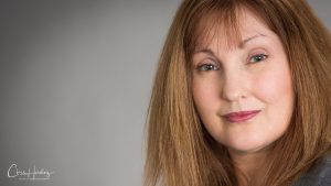 Female Studio Headshot Grey Backdrop